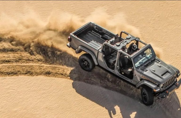 2021 Jeep Gladiator driving on sand