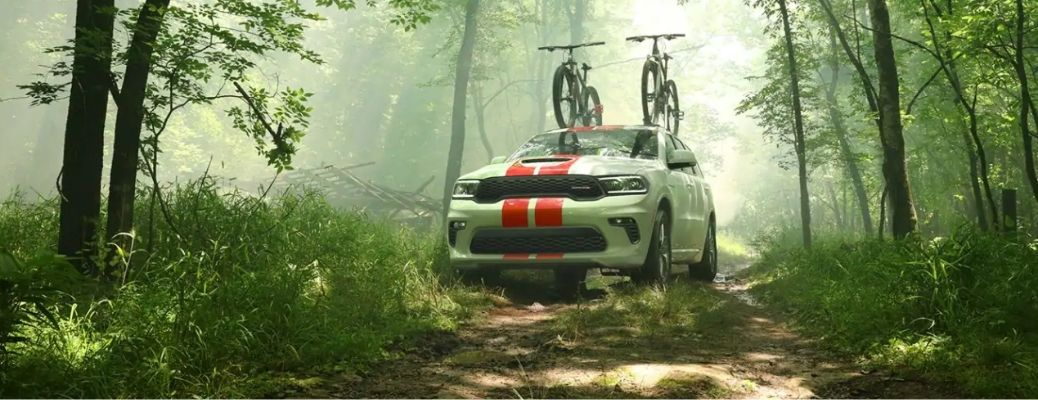 2021 Dodge Durango driving front view in forest