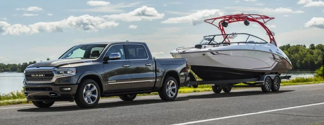 2021 RAM 1500 towing a boat side view