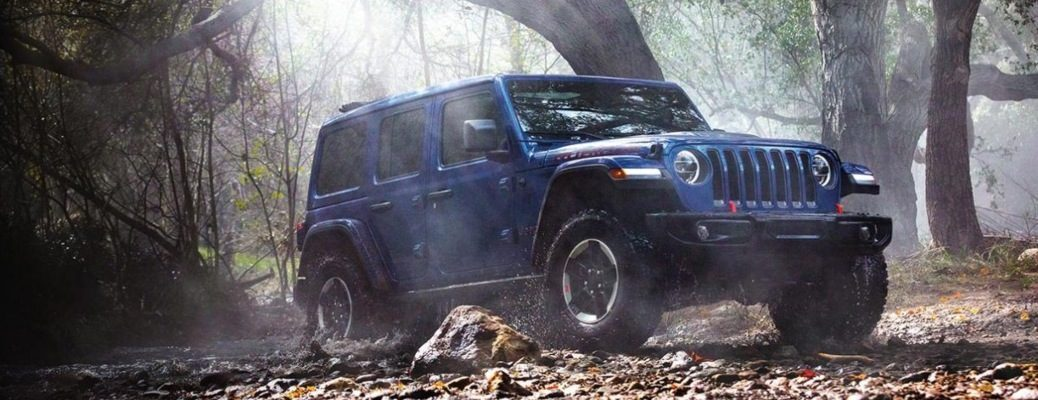 2020 Jeep Wrangler blue in a forest off-road