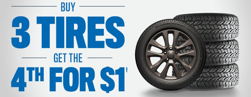 "An image of four tires with a caption that reads: ""Buy 3 Tires get the 4th for one dollar."""
