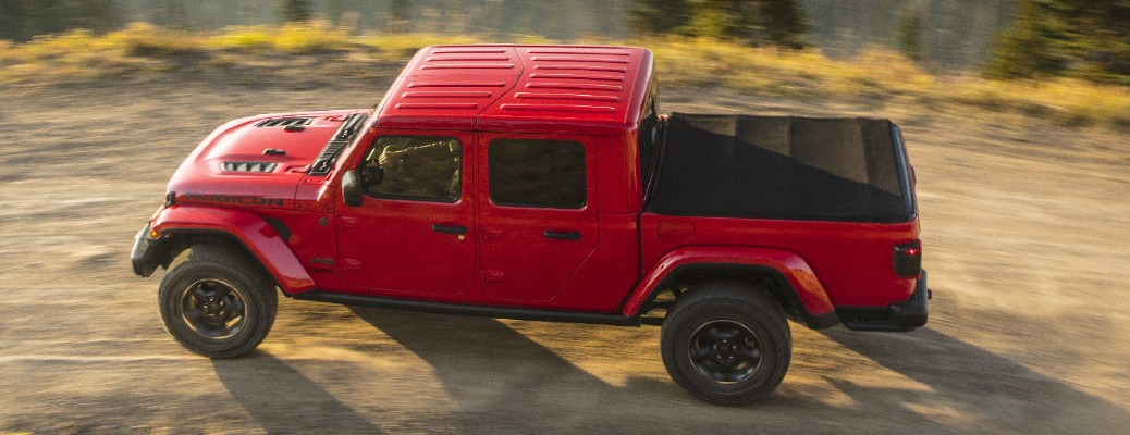The top and side view of a red 2020 Jeep Gladiator driving off-road.
