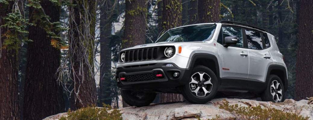 The front and side view of a white 2020 Jeep Renegade.