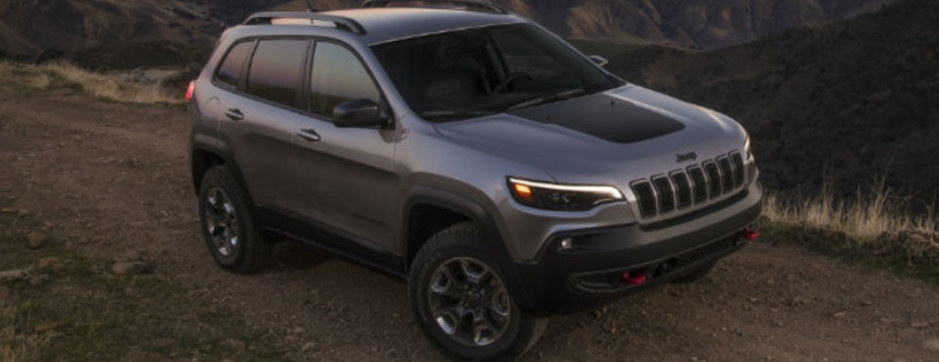 A 2021 Jeep Cherokee driving on a road