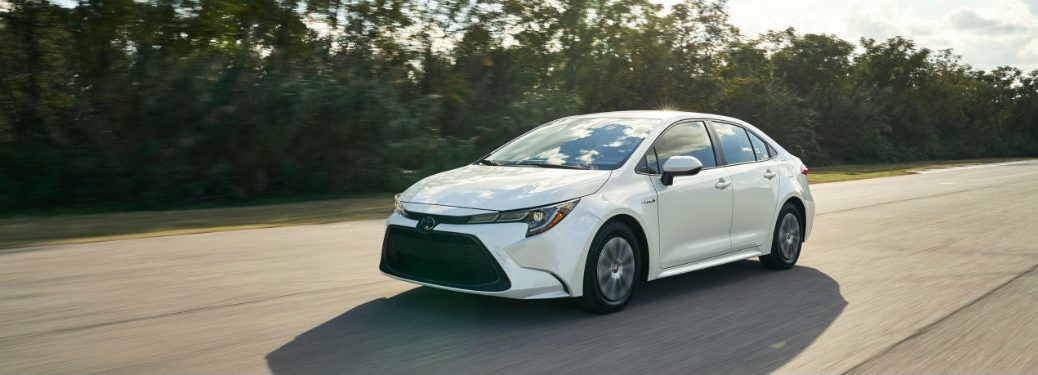 2020 Toyota Corolla white exterior front fascia driver side driving