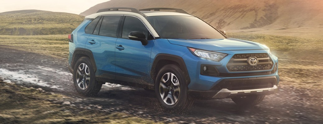 A blue 2020 Toyota RAV4 driving off-road.