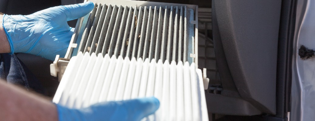 An air filter being replaced by a mechanic.