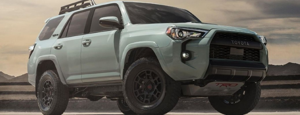The front and side view of a light green 2021 Toyota 4Runner.