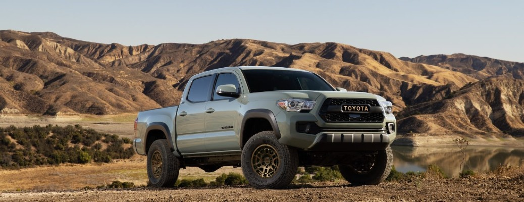 The front side of a light green 2022 Toyota Tacoma Trail Special Edition.