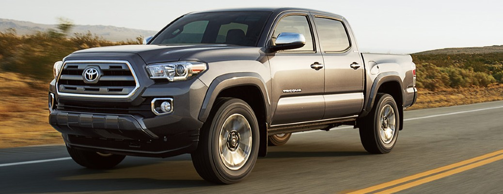 The front and side view of a gray 2017 Toyota Tacoma.