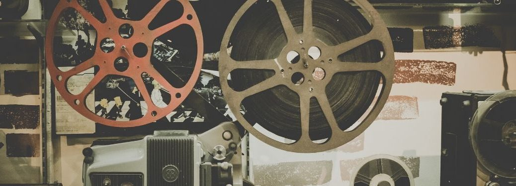 Close-up on old reels of film hooked up to a camera