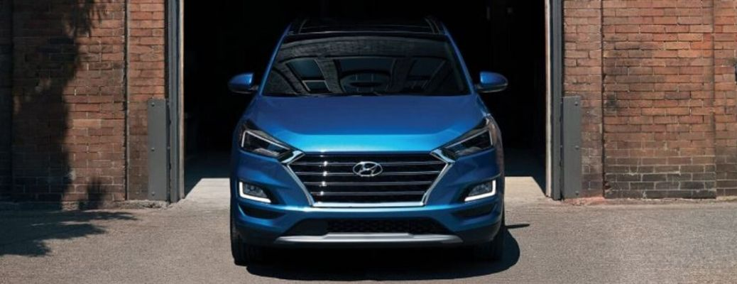 Blue 2020 Hyundai Tucson emerges from a garage