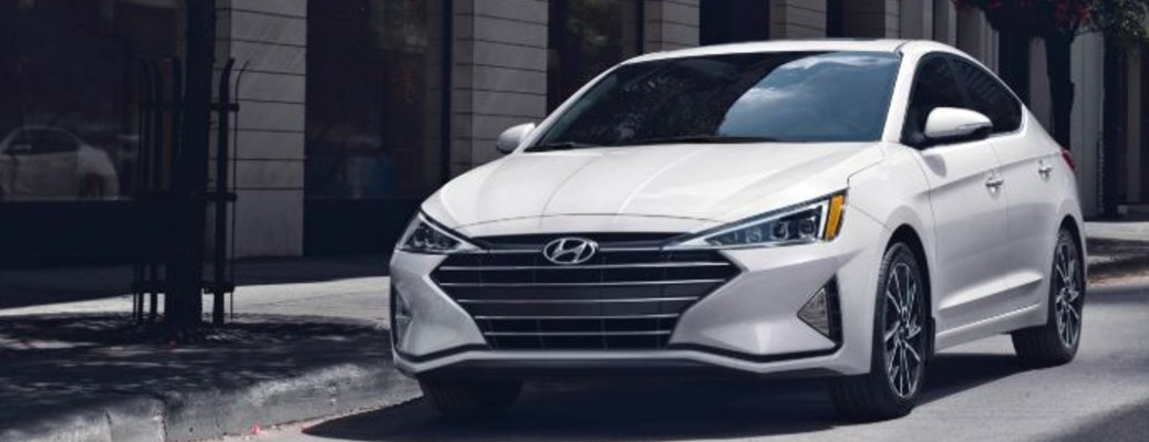 White 2020 Hyundai Elantra parked on a city street