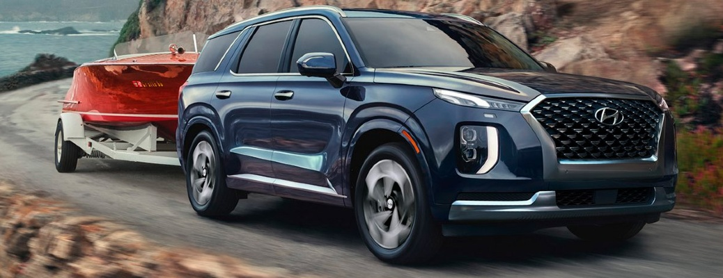 2021 Hyundai Palisade drives up a mountain road