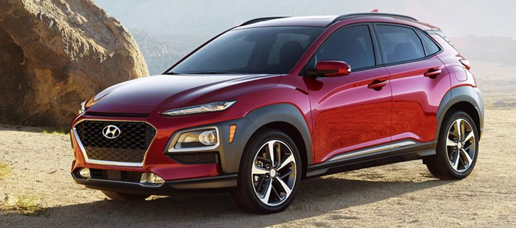 Red 2021 Hyundai Kona sits offroad in a dry place