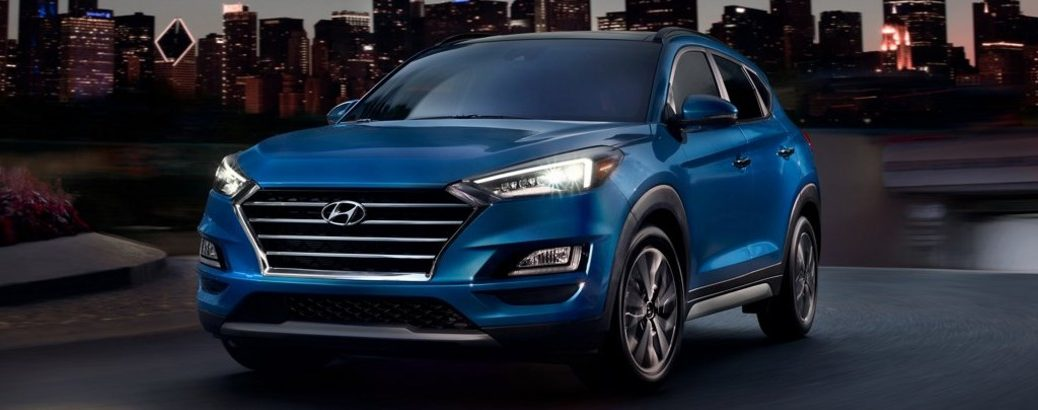 Front/side angled view of a blue 2021 Hyundai Tucson