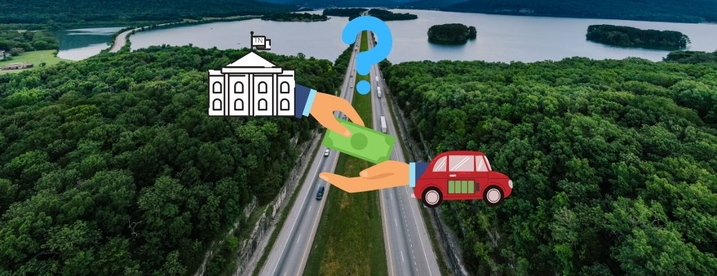 A government hand gives money to a hand emerging from an electric car in Tennessee