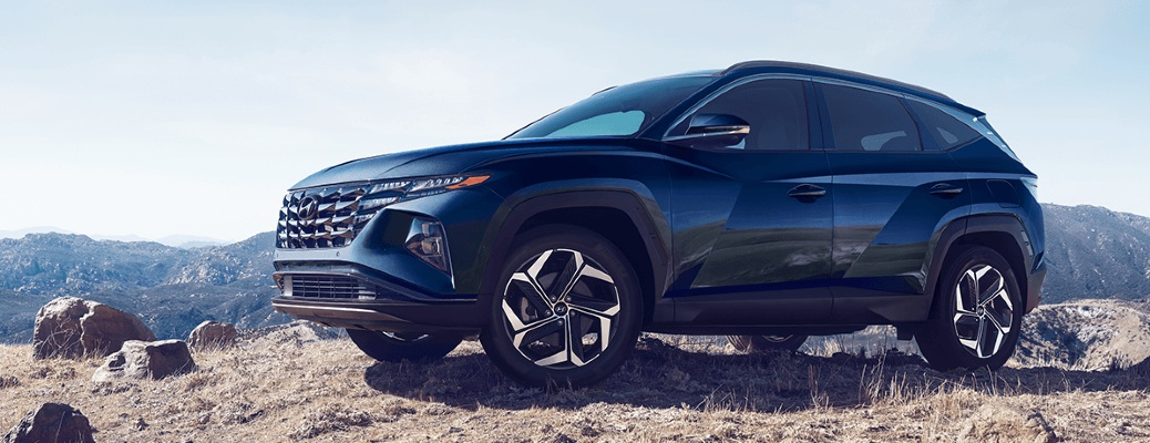 Front/side angled view of a 2022 Hyundai Tucson in a desert