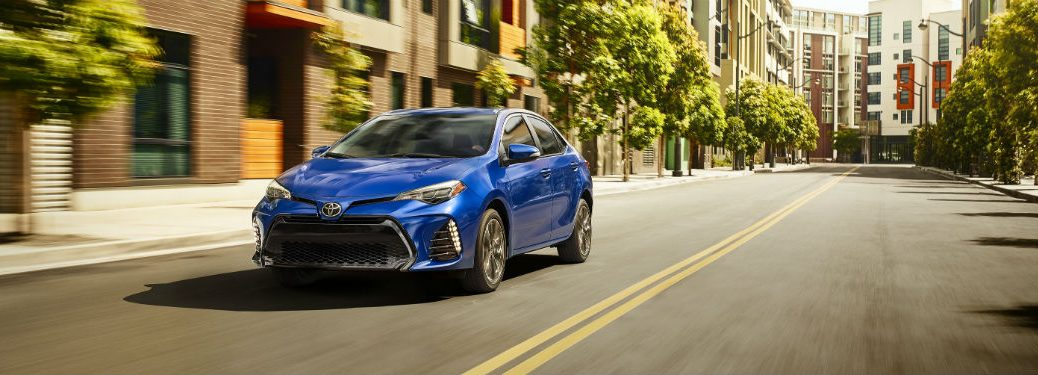 Front driver side exterior view of a blue 2019 Toyota Corolla