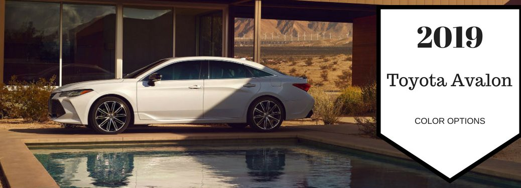 2019 Toyota Avalon Color Options, text on a driver side exterior image of a white 2019 Toyota Avalon