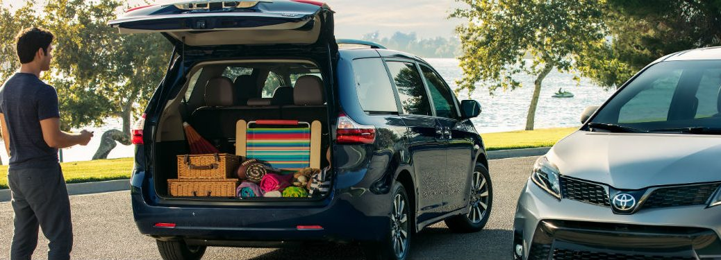 Rear exterior view of the 2019 Toyota Sienna with the rear lift gate open and the cargo area full of cargo