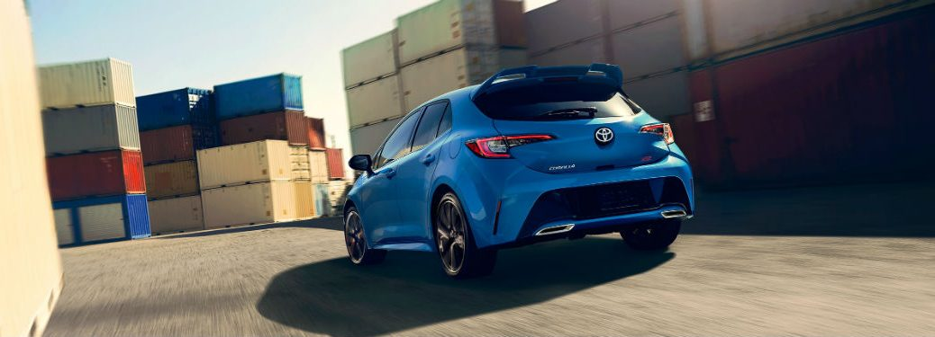 Rear exterior view of a blue 2019 Toyota Corolla Hatchback