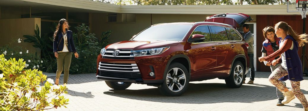 Driver side exterior view of a red 2019 Toyota Highlander
