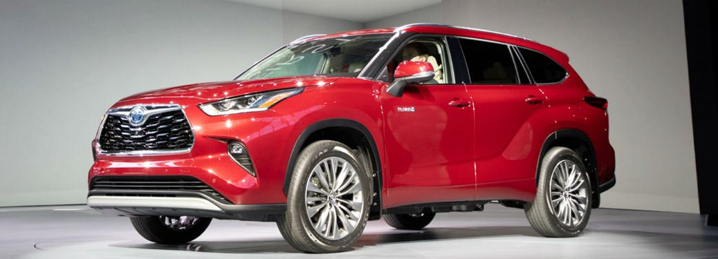 Driver side exterior view of a red 2020 Toyota Highlander