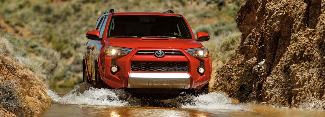 2020 Toyota 4Runner in red driving through water