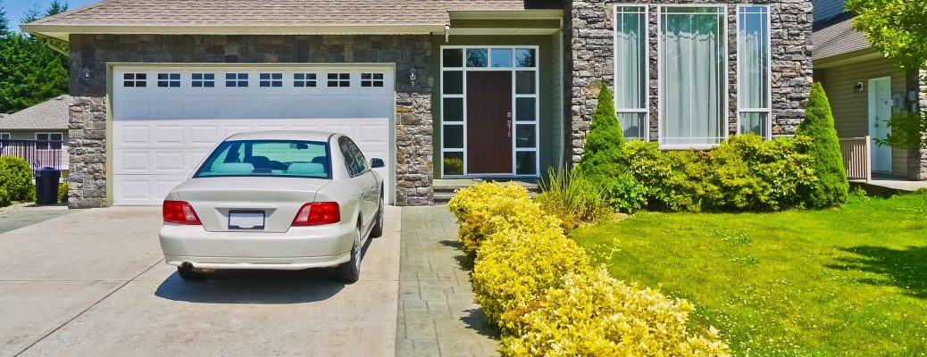 A stock photo of a car sitting alone in a driveway.