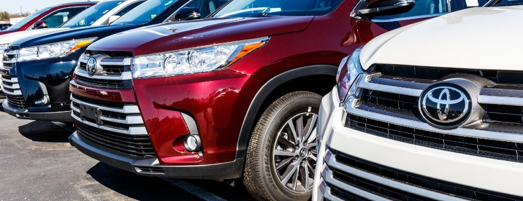 A stock photo of vehicles lined up at a Toyota dealership.