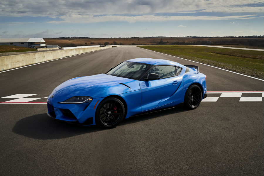 A front left quarter photo of the 2021 Toyota Supra A91 parked on a race track.