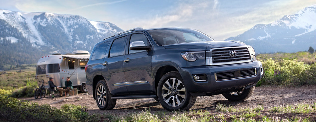 Dark blue 2020 Toyota Sequoia parked near a camping trailer