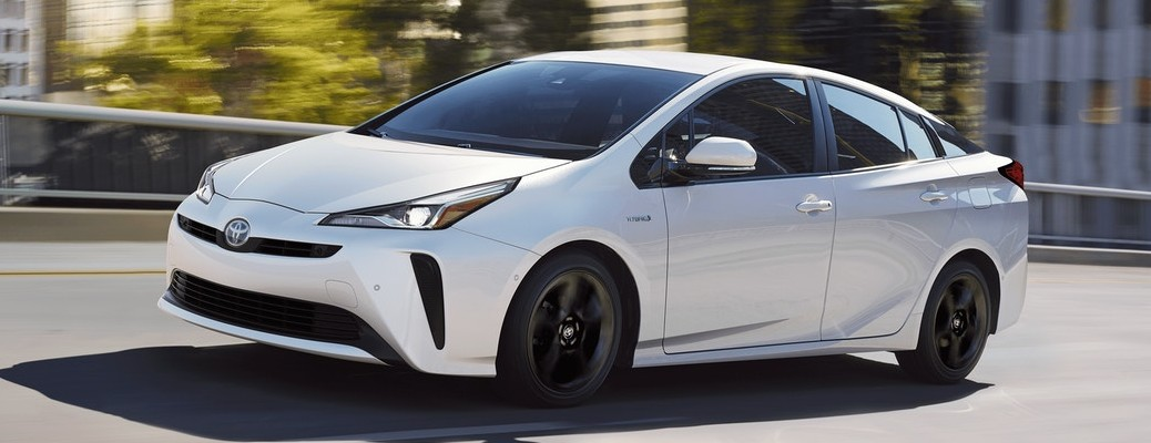 Driver's side front angle view of white 2020 Toyota Prius