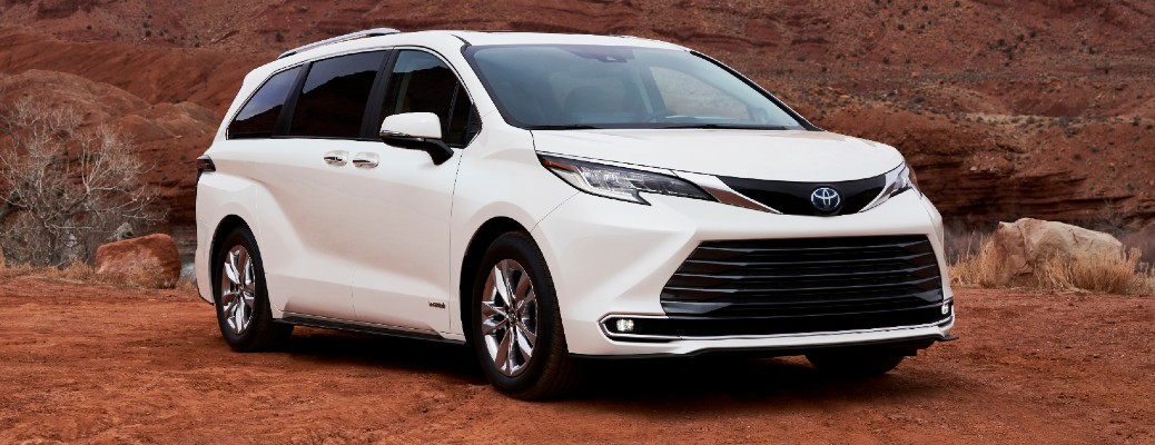 Passenger's side front angle view of white 2021 Toyota Sienna