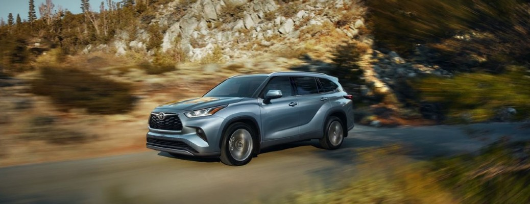 2021 Toyota Highlander driving on dirt path