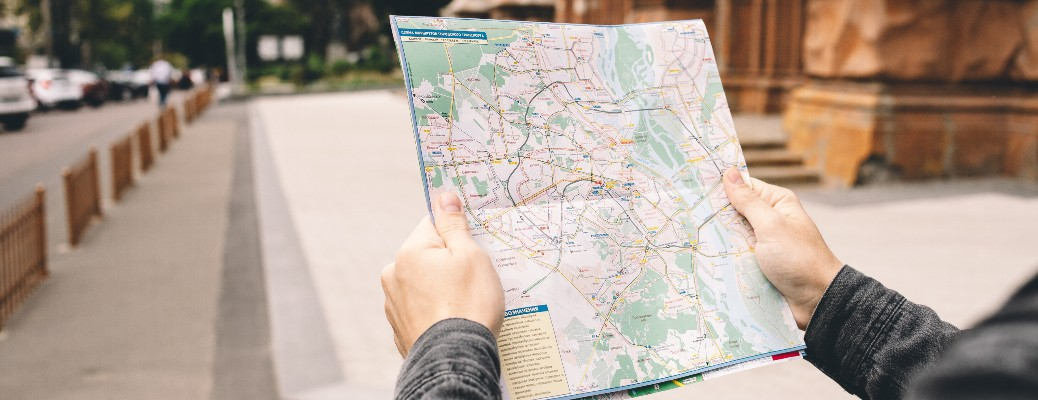 two hands holding a paper map