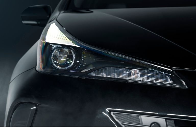 2022 Toyota Prius Nightshade front headlight zoomed in.