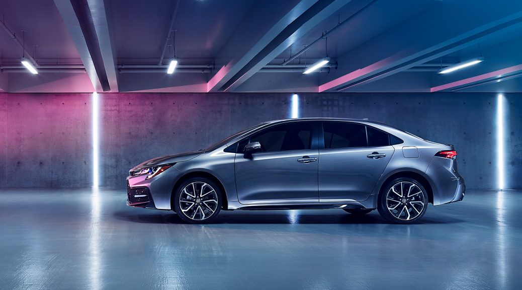 Image of a silver 2020 Toyota Corolla parked in a lighted parking garage.