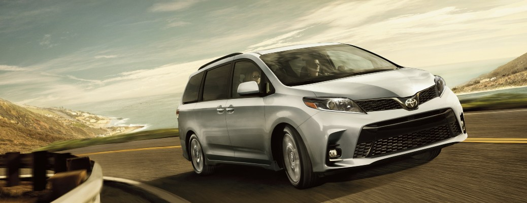 2020 Toyota Sienna silver driving around curved road