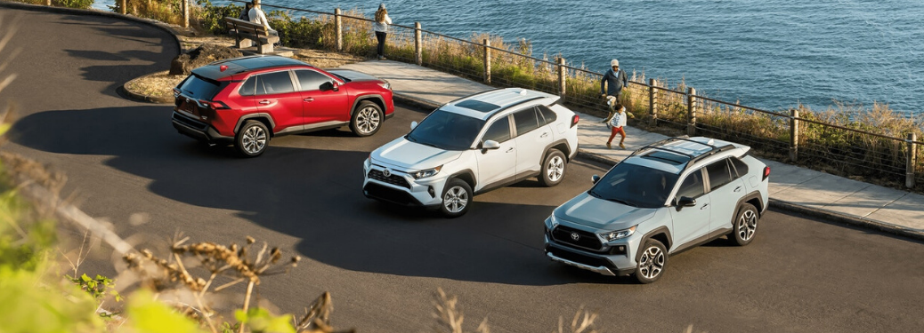 Red, White and Gray 2020 Toyota RAV4 Models Next to the Ocean