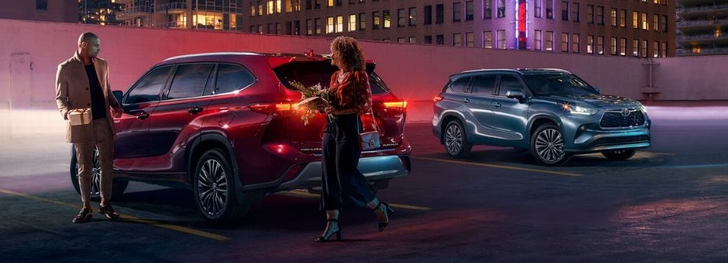 Red and Blue 2020 Toyota Highlander Models in a Parking Lot at Night