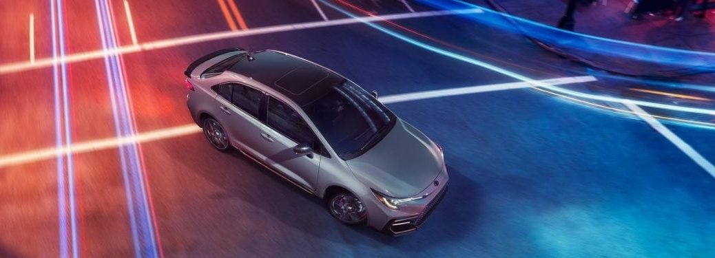 Overhead View of Silver 2021 Toyota Corolla Apex Edition on Colorful Background