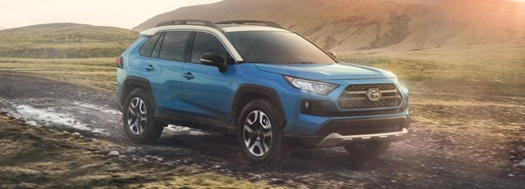 Blue Flame 2020 Toyota RAV4 with Ice Edge Roof on Muddy Trail