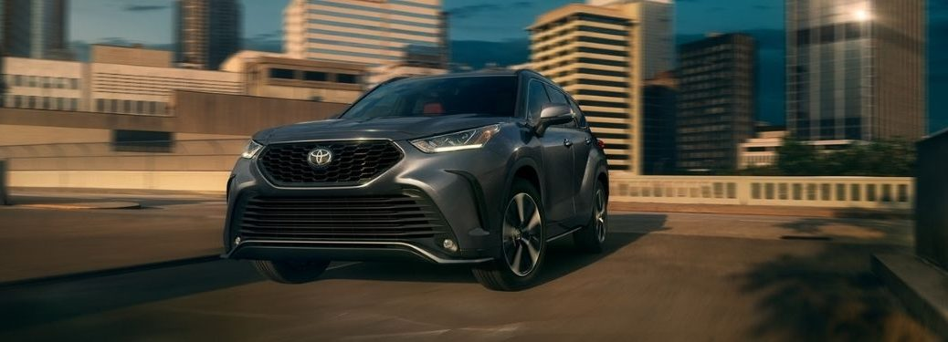 Gray 2021 Toyota Highlander XSE Front Exterior on a Freeway