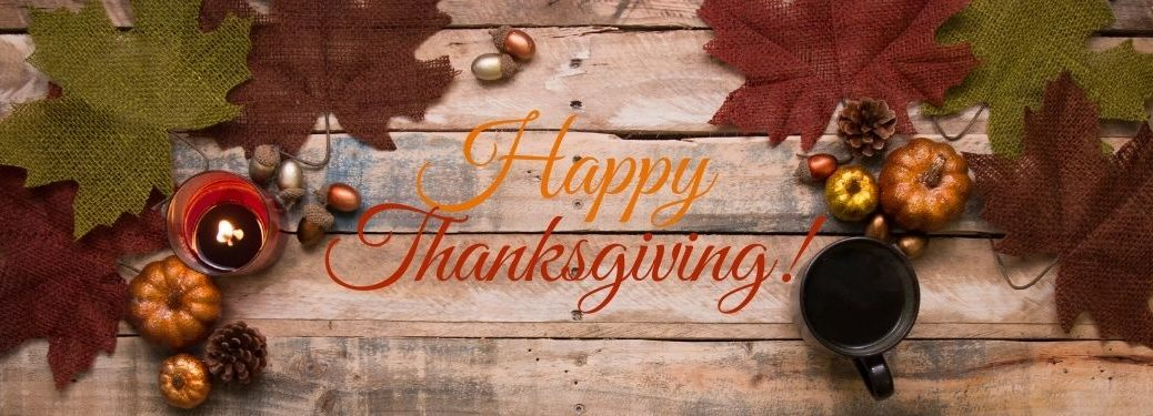 Wood and Fall Decor Background with Orange and Red Happy Thanksgiving Text