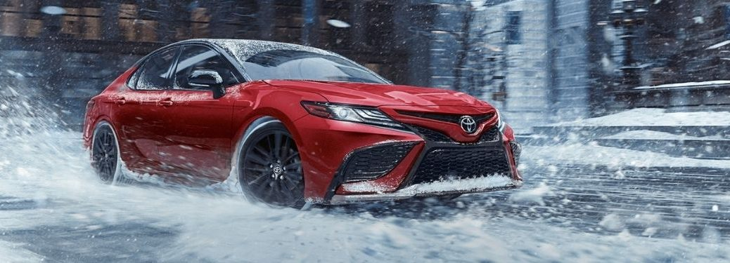 Red 2021 Toyota Camry Driving in Snow with AWD