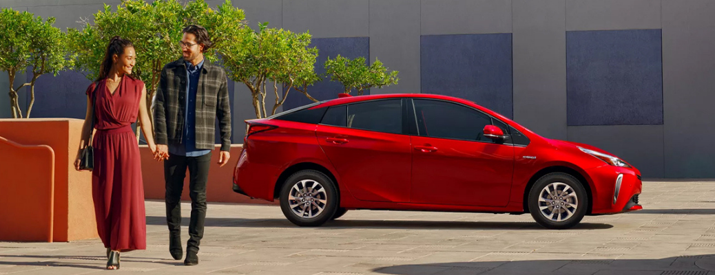 A couple walking out of the 2022 Toyota Prius