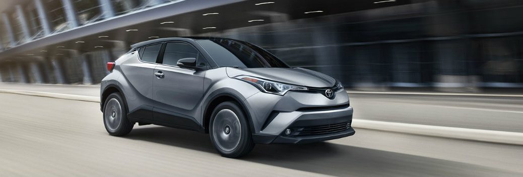 2019 Toyota C-HR gray driving down highway stage left