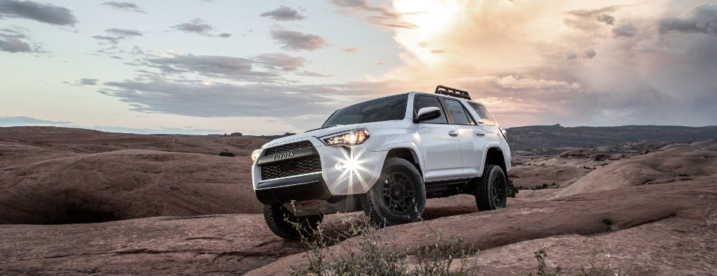 2020 Toyota 4Runner TRD Pro driving over a hill at sunset